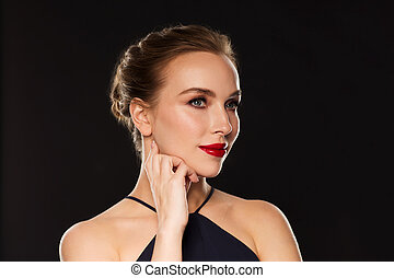 beautiful woman in black over dark background