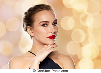 beautiful woman in black over holidays lights