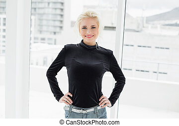 Beautiful woman in black with hands on hips