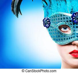 Beautiful woman in blue carnival mask