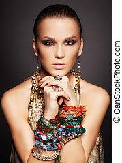 beautiful woman in bracelets - portrait of beautiful young...