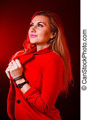 Beautiful woman in bright red lights