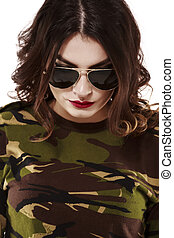 beautiful woman in camouflage shirt and jeans, style concept