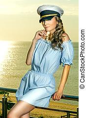 Beautiful woman in captain hat