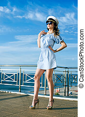 Beautiful woman in captain hat - Attractive beautiful woman...