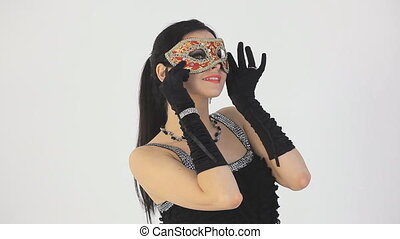 Beautiful woman in carnival mask. White background