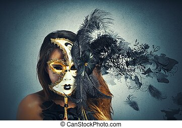 Beautiful woman in carnival mask with motion effect