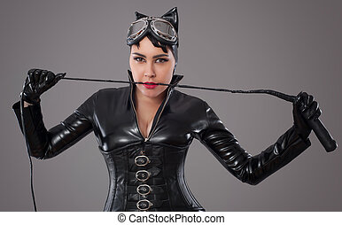 1431c7d80f1 Beautiful woman in catwoman leather latex whith whip.