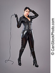 97f4174c7f8 Catwoman. Hot beautiful model in latex cat costume holding tail in ...