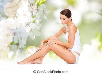 beautiful woman in cotton underwear touching legs - people,...