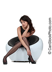 beautiful woman in elegant dress sitting