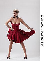 Beautiful woman in elegant dress standing