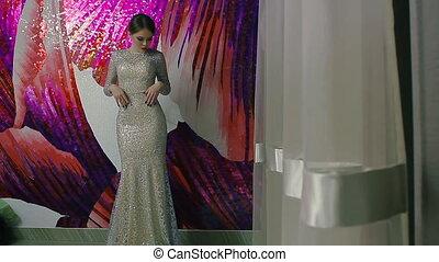 beautiful woman in elegant evening white dress posing
