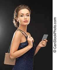 beautiful woman in evening dress with small bag