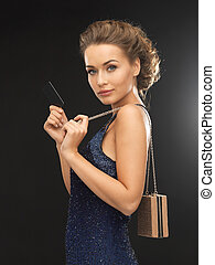 beautiful woman in evening dress with vip card