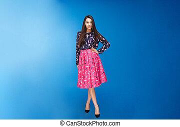 Beautiful woman in fashion dress