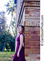 Beautiful woman in front of an old building
