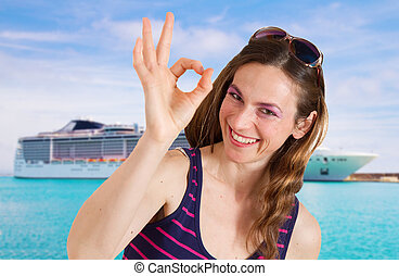 beautiful woman in front of cruise ship