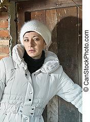 beautiful woman in front of the old wooden door