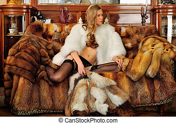 Beautiful woman in fur coat in a luxurious classical...
