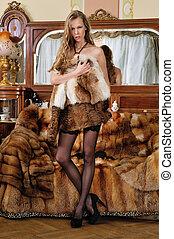 Beautiful woman in fur coat in a luxurious classical...