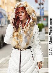 Beautiful Woman In Fur Coat On Street