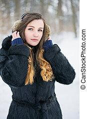 Beautiful woman in fur headphones
