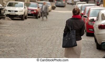 beautiful woman in glasses walking