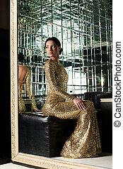 Beautiful woman in gold dress