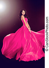 Beautiful woman in gorgeous dress isolated on black background. Full length Portrait. Fashion Photo.