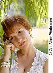 Beautiful woman in green garden