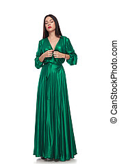 beautiful woman in green long dress standing with eyes ...
