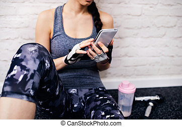 Beautiful woman in gym - Young beautiful women working out...