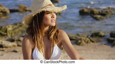 Beautiful woman in hat and bikini near ocean - Beautiful...