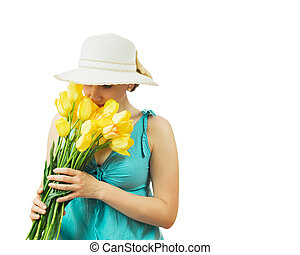 Beautiful woman in hat breathes the scent of spring flowers isolated on white background.