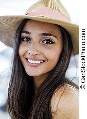 Beautiful woman in hat smiling