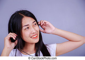 woman in headphones listening to music