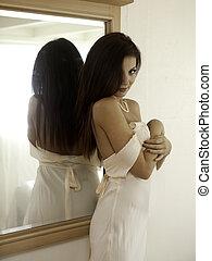 beautiful woman in her bedroom