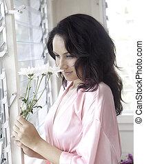 beautiful woman in her boudoir