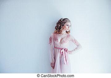beautiful woman in her underwear before the wedding