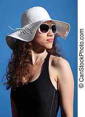 Beautiful woman in hot sun swimsuit shades and hat - Soaking...