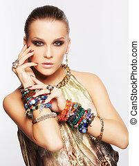 beautiful woman in jewelry - portrait of beautiful young ...