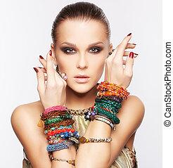 beautiful woman in jewelry - portrait of beautiful young...