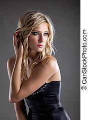 Beautiful woman in leather corset