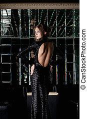 Beautiful woman in long black dress