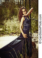 beautiful woman in long blue dress