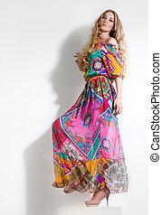 Beautiful woman in long colorful dress