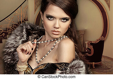 Beautiful woman in luxury interior. Jewelry and Beauty.