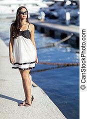 Beautiful woman in marina posing