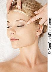 beautiful woman in massage salon